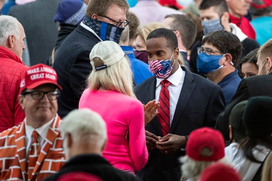 Senate candidate John James speaks with attendees at a President Donald Trump rally at the MBS International Airport in Freeland on Sept. 10, 2020.
