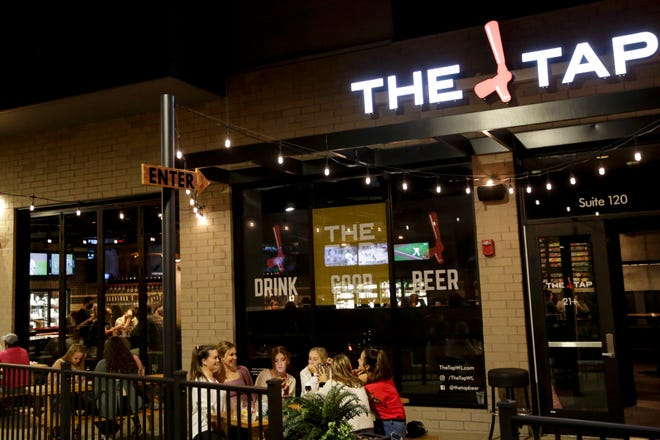 Customers sit in an outdoor seating area at The Tap, 100 S. Chauncey Ave., Wednesday, Sept. 23, 2020 in West Lafayette.