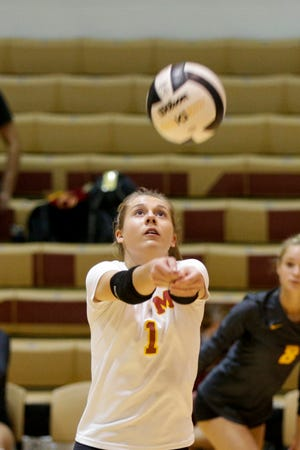 McCutcheon's Raegan Burns (1) hits the ball during the first set of an IHSAA volleyball game, Wednesday, Sept. 23, 2020 in Lafayette.