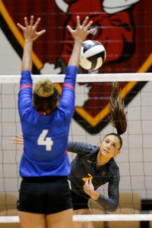 McCutcheon's Chloe Chicoine (2) hits the ball during the first set of an IHSAA volleyball game, Wednesday, Sept. 23, 2020 in Lafayette.