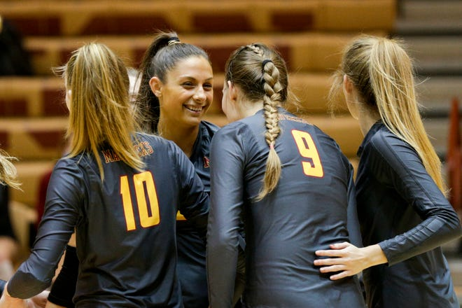 McCutcheon's Chloe Chicoine (2) celebrates a kill during the first set of an IHSAA volleyball game, Wednesday, Sept. 23, 2020 in Lafayette.