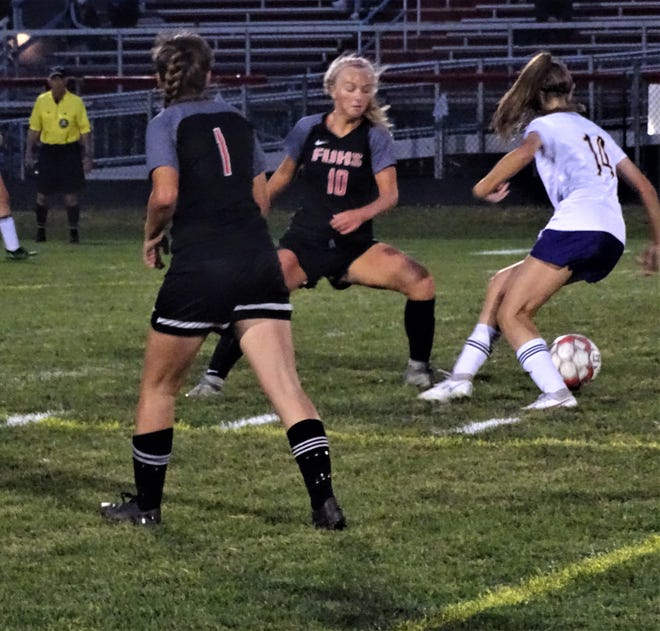 Bloom-Carroll's Jordyn Adams keeps to the ball away from Fairfield Union's Kenedie Barnhart during Wednesday's Mid-State League-Buckeye Division game. The Falcons won 5-0.