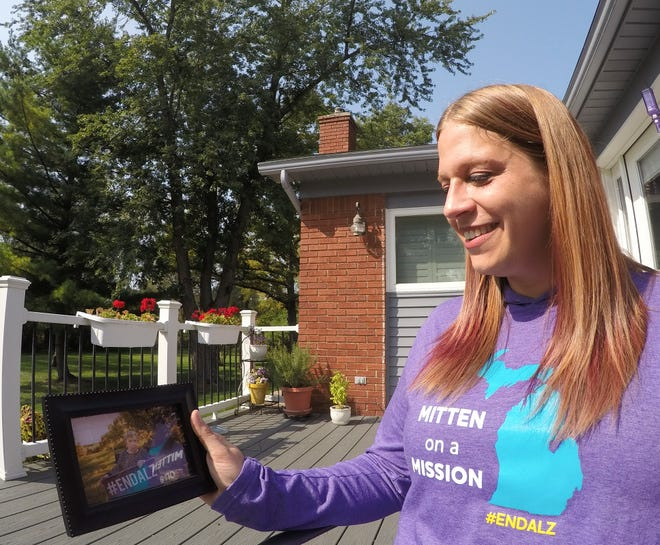 Lauren Kovach holds a photo of her grandmother, Helen Tannas, who died from Alzheimer's disease at her Brighton Township home Thursday, Sept. 24, 2020. Kovach has been named Alzheimer's Association Michigan Chapter 2020 Advocate of the Year for her work with state and national senators and representatives to battle the disease.