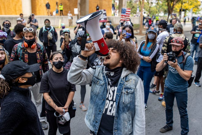 Travis Nagdy leads chants for the release of fellow protesters and 502 Livestreamers outside Metro Corrections on Thursday afternoon. 127 protesters were arrested Wednesday during protests following the announcement of the grand jury's decision in the Breonna Taylor case. Sept. 24, 2020