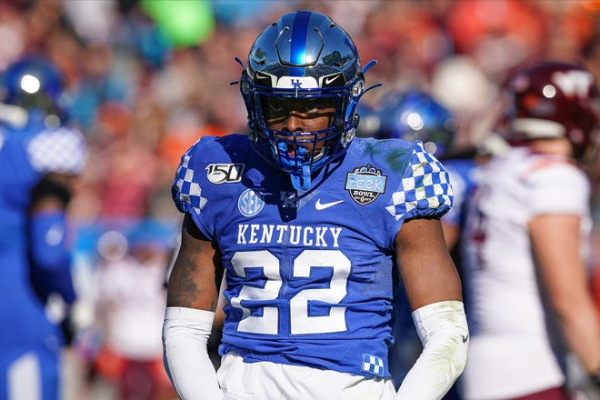 Dec 31, 2019; Charlotte, North Carolina, USA;  Kentucky Wildcats linebacker Chris Oats (22) reacts to his sack during the second quarter against the Virginia Tech Hokies at the Belk Bowl at Bank of America Stadium.