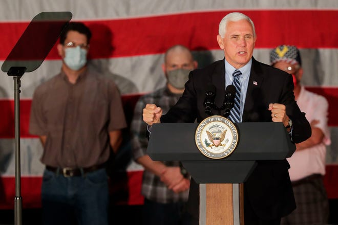 """Vice President Mike Pence addresses supporters on Thursday, September 24, 2020, at Midwest Manufacturing in Eau Claire, Wis. Pence toured the facility and addressed supporters as part of a """"Made in America"""" event stressing the importance of the American manufacturing industry."""