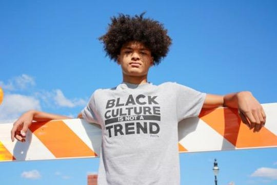 """An equity T-shirt sold by Kohl's says, """"Black Culture is not a Trend."""" The shirts were printed locally."""