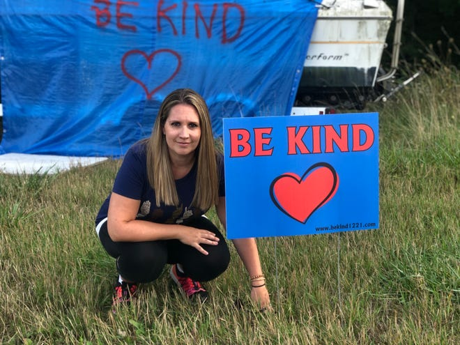"""After a boat was vandalized with the words """"F--- BLM!"""" across fromRichmond Elementary School,N56 W26530 Richmond Road, Lisbon, two neighbors covered that message with a blue tarp with the words """"Be Kind"""" on Aug. 7. Bethany Bernhard started making yard signs Sept. 15 with the same message."""