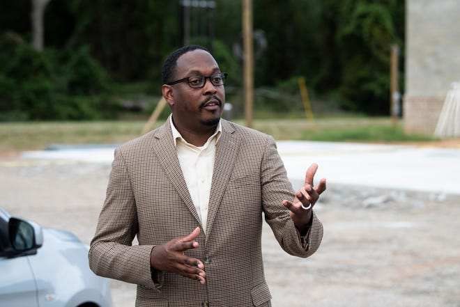 Resident Carlton Avery talks infront of a proposed gas station and liquor store at the intersection of Wares Ferry Road and McLemore Drive in Montgomery, Ala., on Wednesday, Sept. 23, 2020.