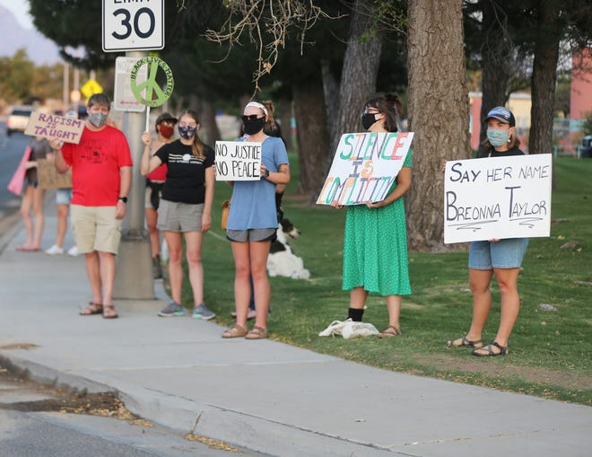 Protesters gather at the intersection of Picacho Avenue and Main Street in Las Cruces on Wednesday Sept. 23, 2020, to protest the decision not to indict the officers who fatally shot Breonna Taylor in Louisville, Kentucky, earlier this year.