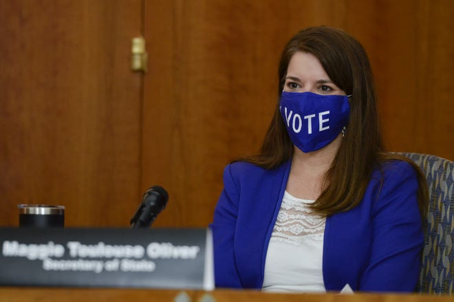 New Mexico Secretary of State Maggie Toulouse Oliver wears a mask during a news conference at the state Capitol building in Santa Fe on Thursday, Sept. 24, 2020.