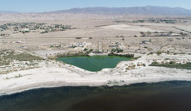 The shoreline of the Salton Sea, bottom, slowly recedes away from the now land-locked marina of the North Shore Yacht Club, center, in the community of North Shore on Sept. 24, 2020.