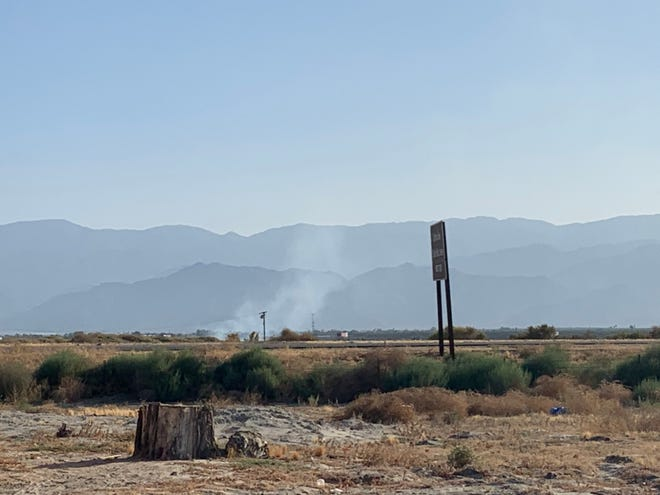 A fire burns near Highway 86 in Coachella on Sept., 24, 2020.