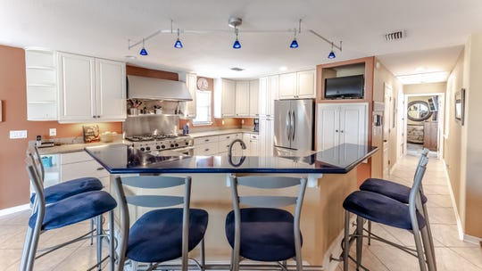 The kitchen includes bar seating.