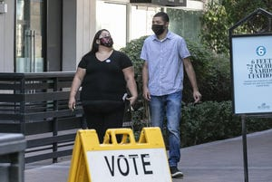 People vote on Election Day at Biltmore Fashion Park in Phoenix on Aug. 4, 2020.