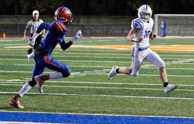 Spring Grove sophomore quarterback Andrew Osmun, right, runs in a touchdown against York High last season. Osmun will look to lead the Rockets to a 2-0 start on Friday against York High.