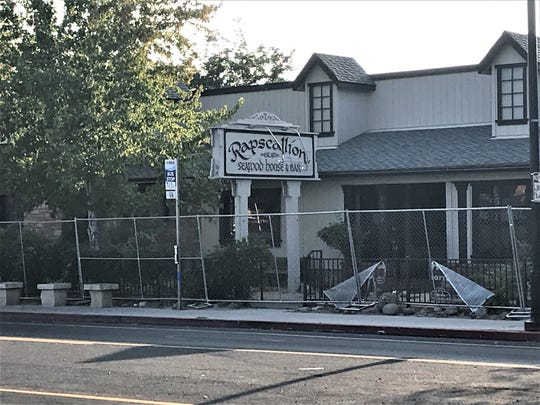 A chain link fence was installed around Rapscallion restaurant on Sept. 21, 2020, to prevent vandalism and trespassing, and in advance of structural work.