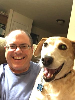 The News Leader reporter Patrick Hite and his dog, Jake.