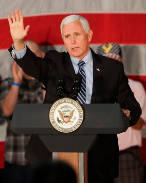 Vice President Mike Pence waves to supporters as he leaves the stage on Sept. 24, 2020, at Midwest Manufacturing in Eau Claire, Wis. Pence is speaking in The Villages on Saturday.