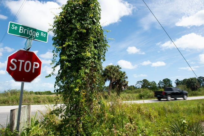 A vehicle travels down a stretch of Southeast Bridge Road, with a posted speed limit of 55 mph, between U.S. 1 in Hobe Sound and Interstate 95 on Wednesday, Sept. 23, 2020, in Martin County. The nonprofit group Guardians of Martin County have documented more than 200 dead animals on that 6-mile stretch of the road between January and August.