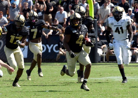 Purdue wide receiver Rondale Moore breaks away from the Vanderbilt defense during their game in 2019 at  Ross-Ade Stadium.