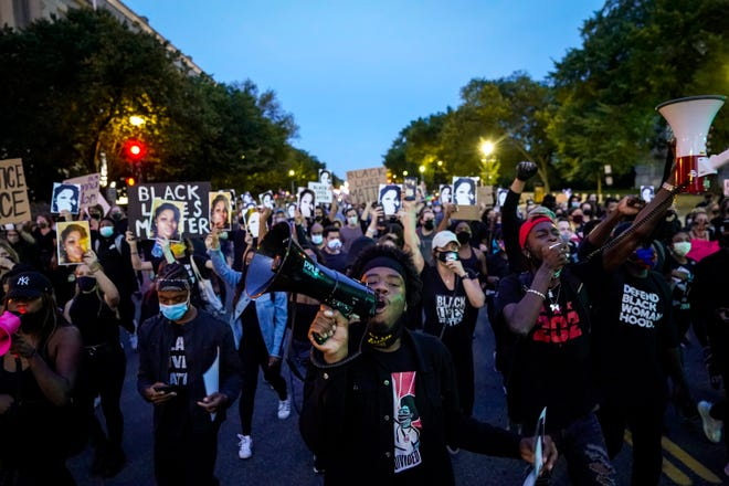 Demonstrators march along Constitution Avenue in protest following a Kentucky grand jury decision in the Breonna Taylor case.