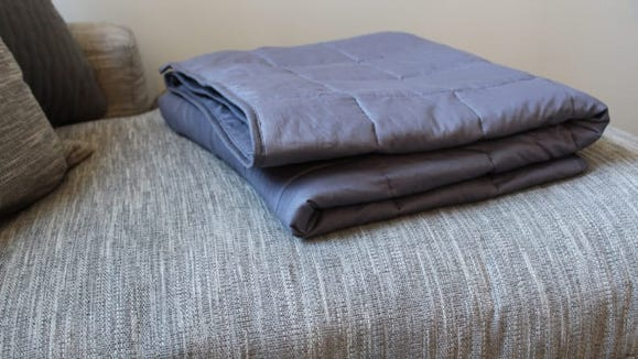 Snuggle into this weighted blanket all fall long.