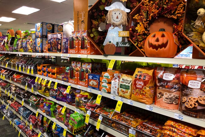 Halloween candy and decorations are displayed at a store, Wednesday, Sept. 23, 2020, in Freeport, Maine.