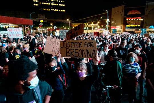 Protesters rally at Barclays Center in the Brooklyn borough of New York on Wednesday night following a Kentucky grand jury's decision not to indict any Louisville police officers for the murder of Breonna Taylor.