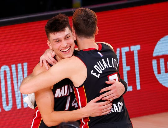 Tyler Herro and Goran Dragic embrace after the Miami Heat defeated the Boston Celtics in Game 4 of the Eastern Conference finals.