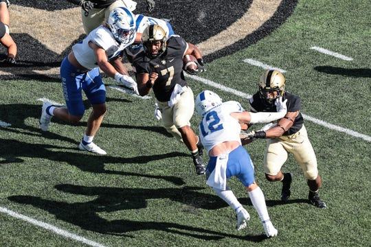 Army quarterback Jemel Jones carries the ball as Middle Tennessee defenders attempt to make a tackle during their game at Michie Stadium.