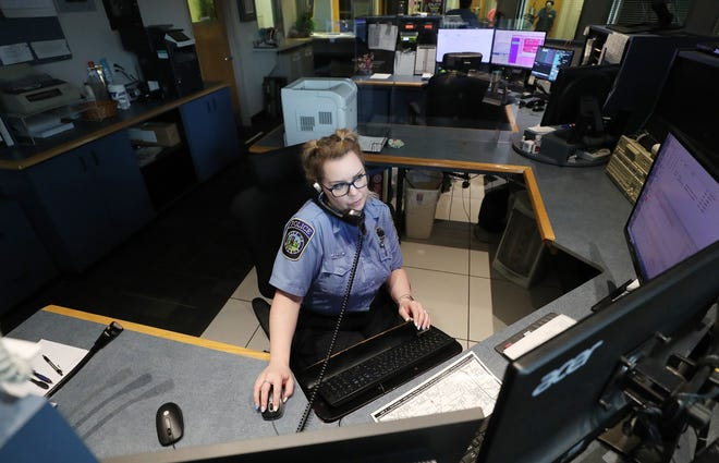 Krista Roch, a dispatcher at Hudson Police Department, takes a call from a citizen about cars speeding in a Hudson neighborhood.