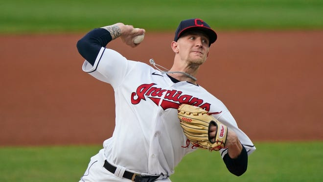 Cleveland Indians starting pitcher Zach Plesac delivers in the first inning of the team's baseball game against the Chicago White Sox, Thursday, Sept. 24, 2020, in Cleveland. (AP Photo/Tony Dejak)