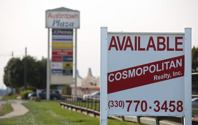 Many of the storefronts at the Austintown Plaza are now vacant in the city west of Yougstown. The original Fitch High School campus is now a vacant lot awaiting a Meijer store.. [Jeff Lange/Akron Beacon Journal]
