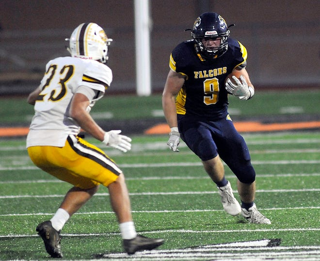 Hillsdale's Ty Williams (9) runs with the ball as Waynedale's Josiah Raber (23) closes in during high school football on Thursday at Ashland Community Stadium. Williams broke Hillsdale's career record for tackles in the game.
