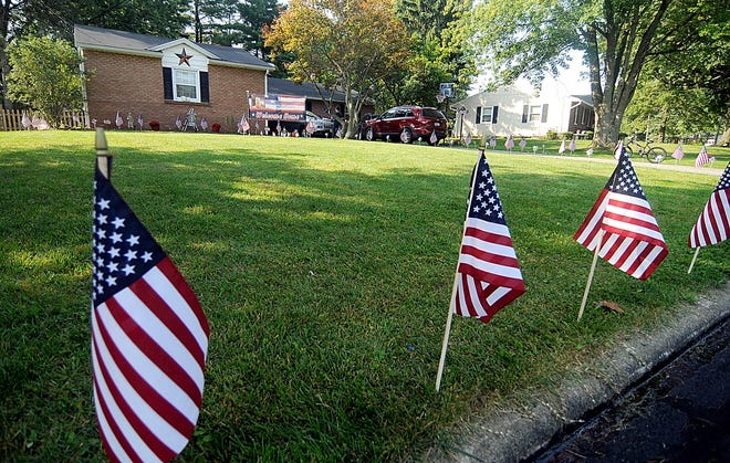 American flags were lined along Cooper Drive, along with a Welcome Home sign in the front lawn of the home of SSG (Staff Sgt.) Derek Conway.