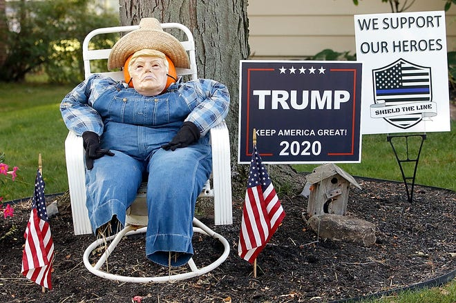 """This fall decoration sitting in a chair on Katherine Avenue has a mask of President Donald J. Trump on it seen here recently. According to the homeowner they wanted to do something to bring a smile to the many people who walk by so she put the """"scarecrow"""" in the chair in her front yard. And being a Trump supporter they then decided to put a Trump mask on it and they have received many positive comments and people stopping by to take photos with it."""