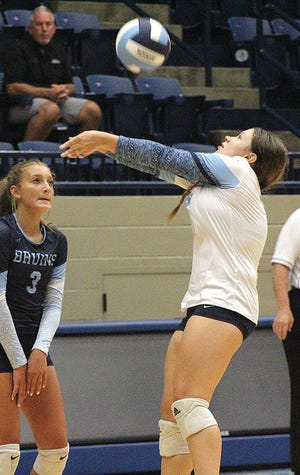 Sydney Collins makes a savvy set during Bartlesville High School varsity volleyball action this season.