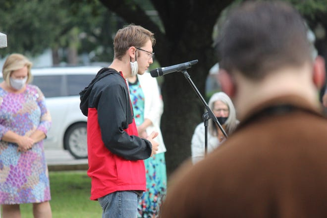BCF student, Isaac Tullis, leads in time of prayer.