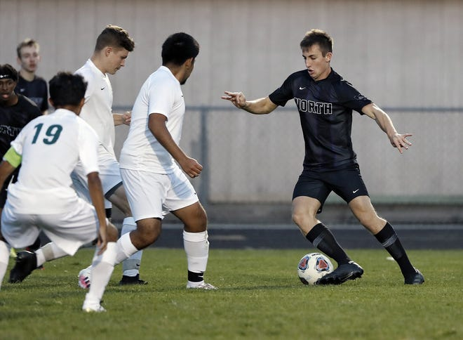 High school soccer in Ohio is facing a shortage of game officials. Here, Pickerington North's Alex Watros dribbles against Westland during a game Tuesday.