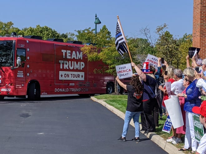 The Team Trump on Tour Bus pulls into Westerville on Friday, where there was an enthusiastic crowd of about 85 Trump supporters. The bus arrived at the president's reelection campaign headquarters on Polaris Parkway. [Darrel Rowland/Dispatch]