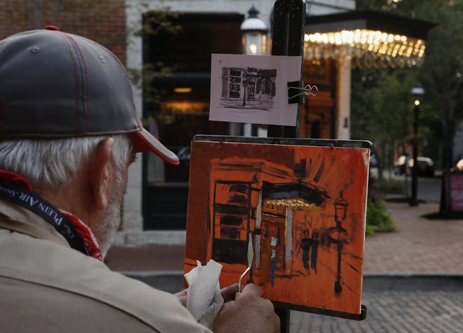 Robin Roberts, 60, of Ashland, paints the scene in front of Lindey's restaurant in German Village as part of the Ohio Plein Air Society competition held in Columbus. The competition, with artists painting outdoor scenes, runs through Sunday.