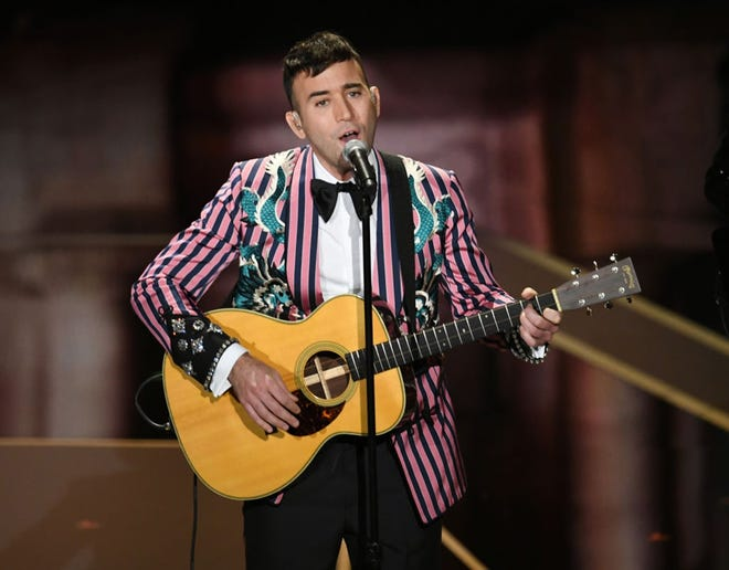 Sufjan Stevens plays during the 2018 Academy Awards show.