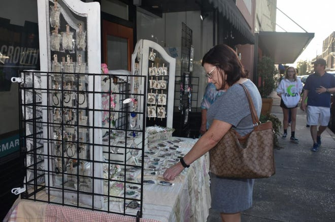 Paula Dufrene browses jewelry at last September's fall Arts Walk in downtown Thibodaux