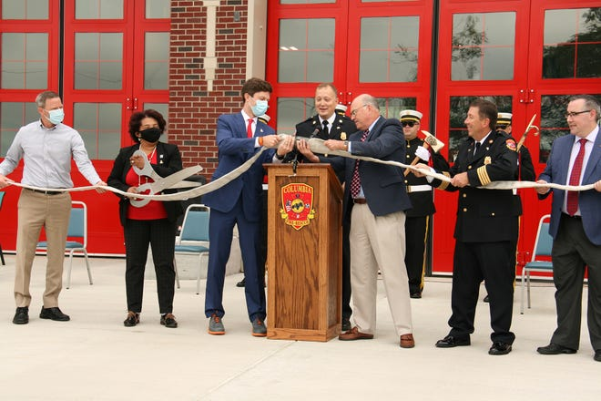 Columbia Mayor Chaz Molder, Fire Chief Ty Cobb and City Manager Tony Masseyuncouple a fire hose at the official dedication Friday of Fire Station 3 on Bear Creek Pike. The $3.2 million station has been operational since April, but the city delayed having a ceremony during the coronavirus pandemic. (Courtesy photo by Jack Cobb)