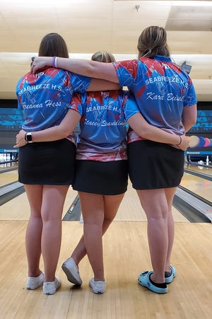 Breanna Hess, from left, Stacey Spaulding, and Kara Beissel celebrate Seabreeze's bowling victory over Atlantic on Wednesday, Sept. 23, 2020.