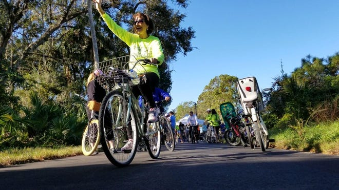 Cyclists enjoy the new Volusia County trail in Edgewater. The Volusia ECHO program has contributed $1 million annually to trails since 2004.