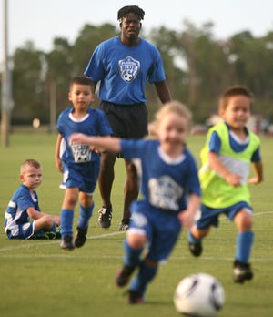 Kenny Bonnett Jr. works with young soccer players at Dewey Boster Soccer Complex in Deltona on September 21, 2011. The park was built using funds from the Volusia ECHO program.