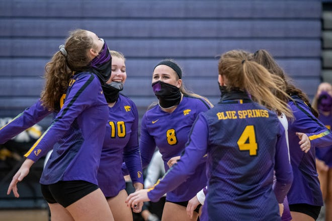 Blue Springs players celebrate a point during Thursday's home match with crosstown rival Blue Springs South. The Wildcats went on to win in three sets.