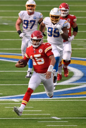 Kansas City Chiefs quarterback Patrick Mahomes (15) runs runs for a long gain against the Chargers in last week's game in Los Angeles. Mahomes, known for his arm, showed how dangerous he can be with his legs too.